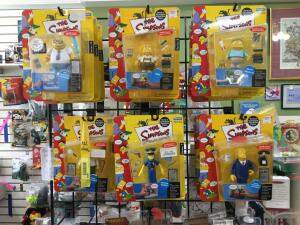 Approximately 16 Simpsons figurines, three Pirates of the Caribbean figurines. All new in package and then three additional Pirates of the Caribbean figurines.