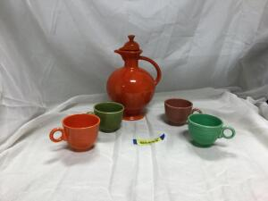 Carafe and 4 Teacups-Carafe does have a repaired spot and 1 cup has a crack See photos