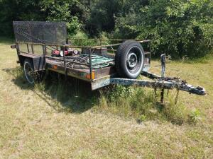 "5 x 10 single axle trailer with mesh drive up ramp on probably 15"" car tires Has a 1"" square tube metal rack around it, diamond plate steel fenders. Heavy duty trailer,  looks like it's probably homemade with registration  **Will require wire transfer**"