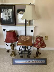 Artwork, table lamps and a lighted magazine rack
