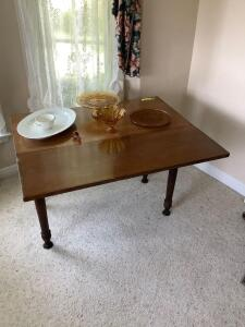 Walnut drop leaf table, three pieces of amber glass, amber decanter stopper, serving platter and sugar bowl Table measures 40 x 18 x 30 Each leaf measures 13""