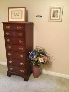 "7 drawer chest of drawers ""Wild Black Cherry"" from the Henkel-Harris Co. measures 22"" x 16"" x 52"", floral decor and framed artwork"
