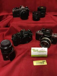 Nikon film cameras including an FM2 and N2020, Vivitar 75-205mm lens. See photos.