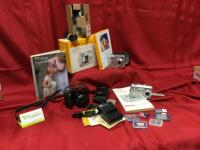 Kodak digital cameras: EasyShare C533 New In Box, CX7525, ZD8612, battery chargers and memory cards.