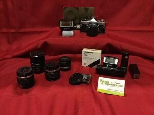Olympus OM1 film camera, 24, 50, 85mm lenses, OM Winder 2, T20 and T32 electronic flashes and extras