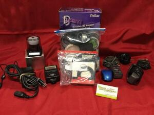 Many assorted filters, Vivitar 3Dcam, box of adapters, electronic flashes and misc. See photos