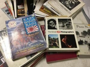 Photography coffee table books and quantity of magazine articles relating to cameras