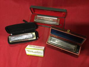 Hohner The Super Chromonica. Harmonicas are in the keys of A, C, and G.