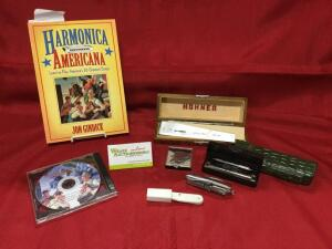 Harmonica America book and Disk 1 of Harmonica America, MoJo harmonica, parts and pocketknives.