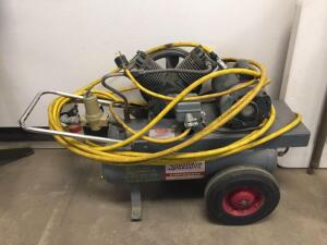 Speedaire compressor model 32319A, 2 H P. 1 phase-works, with air hose