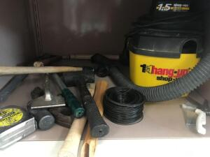 Contents of cabinet-1 gallon shop vac, rubber mallet, hammers, 25 foot tape measure