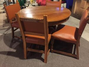"42"" round oak table, four chairs. Table has two small holes in top, still nice condition"