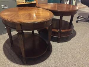 Two oval end tables, one has some damage to top