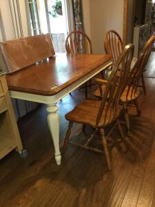 "Modern dining table w 4 chairs (one is a captain) Measures 50 x 39 x 30 with one 12"" leaf"