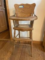Vintage oak child's high chair with cane seat