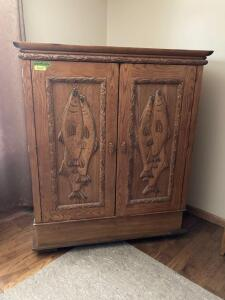 Modern media armoire with fish design Measures 49 x 26 x 63