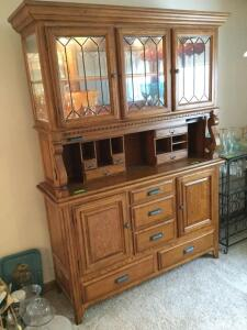 Modern two piece lighted hutch with leaded glass doors on top and lots of storage on the bottom Measures 59 x 19 x 83