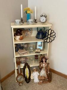 Four tier shelf and all decor-porcelain dolls, McCoy pitcher, tea kettle, china, S & P and more Measures 27 x 12 x 45