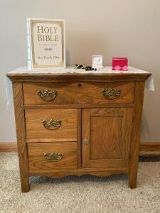 Commode, King James Version Holy Bible and costume jewelry Measures 30x 18 x 28
