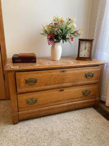 "Oak lowboy dresser on casters, Holy Bible, Seiko radio controlled table clock, table lamp and ""One Minute Prayers for Men""  Dresser measures 44 x 18 x 24"