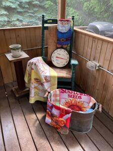 Porch rocker, boiler, plant stand, thermometer, yard flags and a flower pot