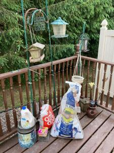 Shepherds hooks and bird feeders, bird seed, planters