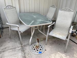Glass top patio table w umbrella base and 3 chairs Table measures 68 x 38 x 28