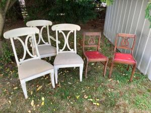 Five dining chairs-a pair and their third wheels. The back of one of the white chairs is broken. See photos.