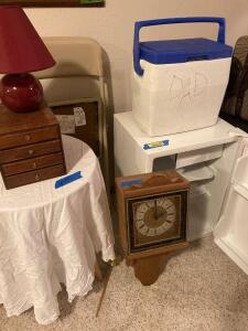 Haier mini fridge 2.7 cu. ft., wall clock, cooler, folding chair, three-legged table, small table lamp and wooden jewelry box. See all photos.