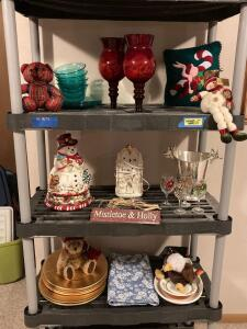 Winter and Christmas decor. Gold plates, snowman runner, snowman cookie jar, light up ceramic nativity scene, deer ice bucket and more. Shelf not included. Interested in the storage shelf-see lot 6558.