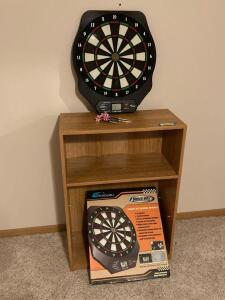 Echowell Direct Hit! eight player LCD electronic dartboard and a one-shelf laminate bookcase. Buyer must remove dartboard from wall.