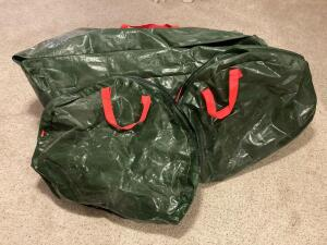 Two Rubbermaid wreaths bags, and one Rubbermaid Christmas tree storage bag with pre-lit tree. Size unknown. Lights untested.