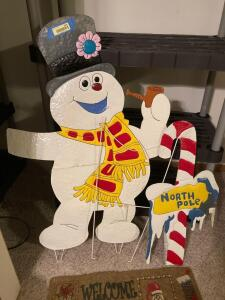 "Frosty the Snowman metal lawn decor (measures 42 x28), seasonal doormats, wreath hanger and a 23"" lighted Santa decoration. Tested and only half of the lights work."