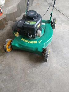 Weed eater 20 in push lawn mower with a Briggs & Stratton 300 series 148cc engine