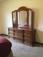 "Modern oak 9 drawer dresser with triple mirror, no brand name Measures 18"" deep x 30""  tall to the top of the dresser 63"" wide and a 45"" mirror"