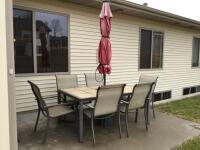 40 x 65 tile top aluminum patio set with 6 chairs and red faded umbrella.  Two chairs are swivel armchairs, others are just straight arm chairs
