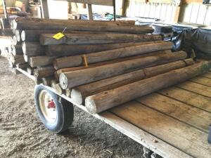 "49 +/- wood posts 6.5' tall by 3"" to 6"" diameter"