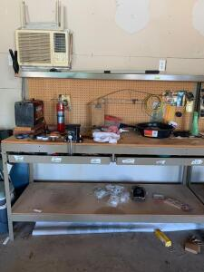 Shop bench and all contents-shelf measures 6' x 2' x 5' Contents include magnet grabber, vise, oil pan, drill bits, caulk gun, DuraStart heavy duty battery and more