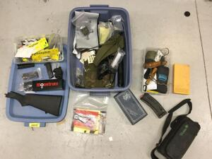 Mixed bag of gun parts includes hand gun magazines, shotgun butt stock, 25 or 30 round A.R. 15 mags, goose calls, AR forearms, mounting rails electric