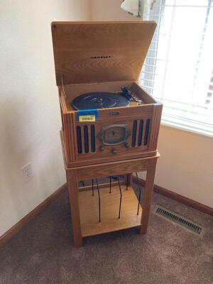 Crosley AM/FM/Phono/cassette player w stand for vinyls Complete setup measures 18 x 15 x 34. Record player and base are two separate pieces.