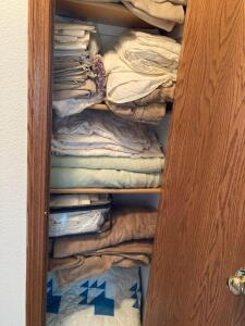All linens in closet-blankets, sheets, etc