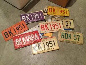 Many license plates- vintage and new, most Illinois
