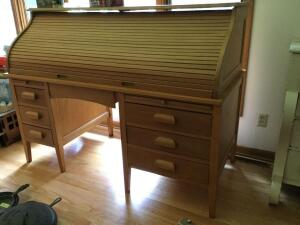 Two piece roll top desk Measures 65 x 30 x 48