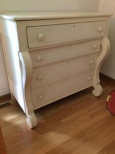 Four drawer vintage dresser Sand off that white paint, polish her up and she'll be good as new! Measures 41 x 20 x 39