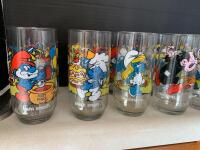 Eleven Smurfs glasses, two Muppets glasses and a Welch's Tyrannosaurus Rex jelly jar glass - 2