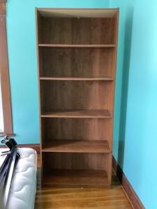 5-shelf particle board bookcase. Measures 72H x 29.5L x 12W. Located upstairs-bring help for moving!