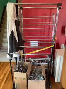 Portable clothes racks, many hangers-wire and plastic, women's size 3X Free Country jacket