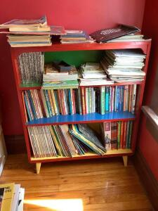 Shelf loaded up with kids books Shelf measures 30 x 10 x 36