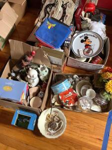 Banks, tins, VHS tapes, costume jewelry, wall decor, collector plates and much more