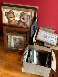 Picture frames of all shapes and sizes, photo albums